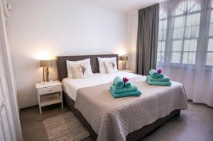 Cama ou camas em um quarto em Palms & Pools apartment at Curacao Ocean Resort