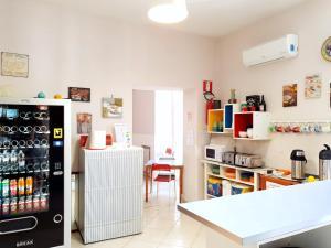 A kitchen or kitchenette at Hostel Mancini Naples
