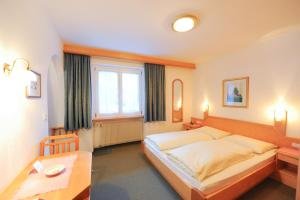 A bed or beds in a room at Pension Panorama