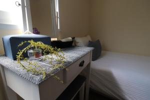 A bed or beds in a room at Just4u Guesthouse