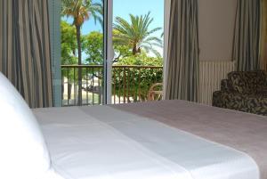 Cama o camas de una habitación en Hotel Rovira