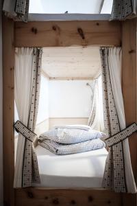 Ein Bett oder Betten in einem Zimmer der Unterkunft Gasthof Fallmühle