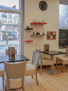 Ein Restaurant oder anderes Speiselokal in der Unterkunft ibis Limoges Centre