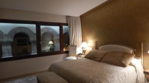 Cama o camas de una habitación en Palau dels Osset