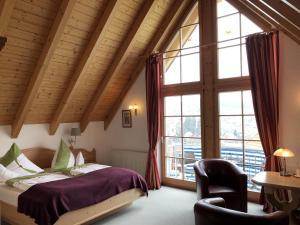 Een bed of bedden in een kamer bij Berghotel Schiller