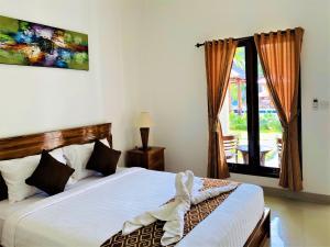 Cama o camas de una habitación en Uluwatu Jungle Villa