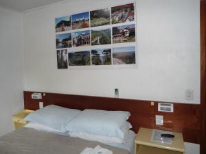 A bed or beds in a room at Ex Pousada Vale do Bosque - Aluguel por temporada