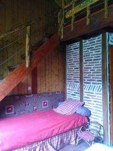 A bed or beds in a room at Au Pas Du Comtois