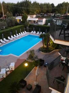 A view of the pool at Hotel Fornaci or nearby