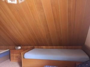 A bed or beds in a room at Haus Franziska