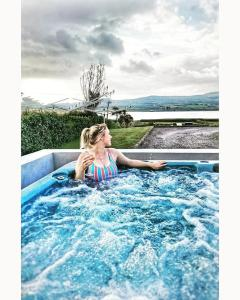The swimming pool at or near Skellig Port Accomodation - 2 Bed Apartment