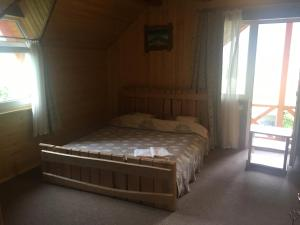A bed or beds in a room at Guest house Zatishniy dvir