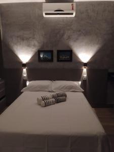 A bed or beds in a room at KIT/LOFT - MUITO PRÓXIMA AO AEROPORTO DE BRASÍLIA