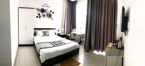 Giường trong phòng chung tại Hotel Sao Khuê