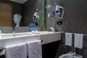 A bathroom at Domina Hotel Novosibirsk