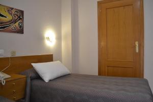 Cama o camas de una habitación en Gran Hotel Toledo