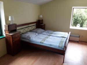 Postel nebo postele na pokoji v ubytování Penzion Zámecká