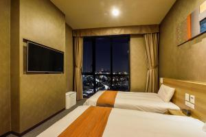 A bed or beds in a room at Dormy Inn SEOUL Gangnam