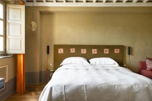 Ein Bett oder Betten in einem Zimmer der Unterkunft Locanda al Colle