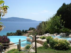 A view of the pool at Villa d'Ortoli 1 or nearby