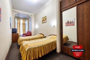 Кровать или кровати в номере Antares by Center Hotels