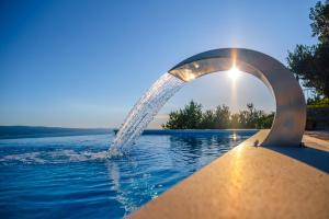 The swimming pool at or close to Villa Secluded Paradise