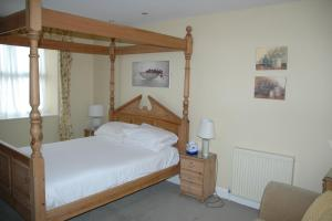 A bed or beds in a room at The Royal Inn