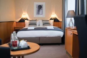Ein Bett oder Betten in einem Zimmer der Unterkunft Hotel Regina