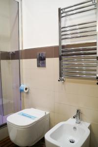 Um banheiro em Hotel Cimarosa