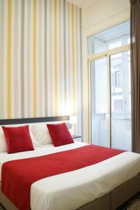Cama ou camas em um quarto em Hotel Cimarosa