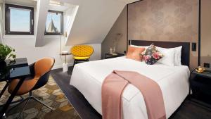 Кровать или кровати в номере Park Plaza Vondelpark Amsterdam