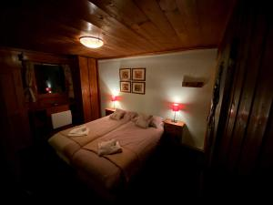 A bed or beds in a room at Chalet Patineur
