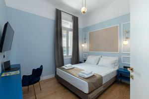 A bed or beds in a room at Belle Epoque Suites