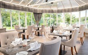 A restaurant or other place to eat at Skeabost House Hotel
