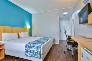 Cama ou camas em um quarto em Comfort Nova Paulista
