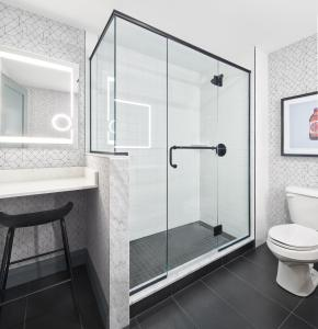 A bathroom at The Carleton Suite Hotel