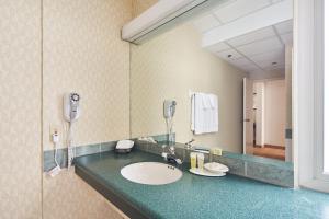 Ванная комната в The Carleton Suite Hotel