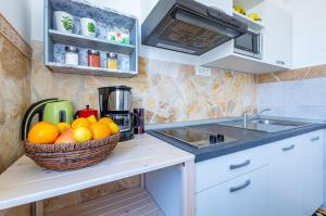 A kitchen or kitchenette at Apartments Maša