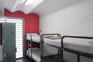 A bed or beds in a room at HelloBCN Youth Hostel Barcelona
