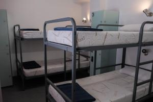 A bunk bed or bunk beds in a room at HelloBCN Youth Hostel Barcelona
