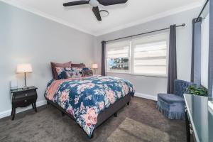 A bed or beds in a room at Long Jetty Lake House
