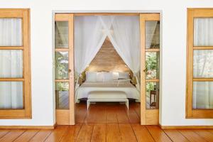 A bed or beds in a room at Nay Palad Hideaway - All Inclusive Stay