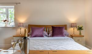 A bed or beds in a room at Slades Farm