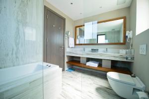 A bathroom at Ramada Resort Bodrum