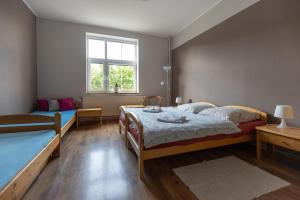 A bed or beds in a room at Pension Vetrny Vrch