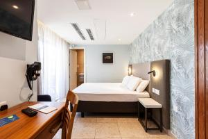 A bed or beds in a room at Pergola Hotel & Spa