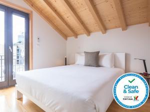Een bed of bedden in een kamer bij InSitu - Trindade