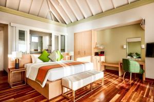 Ein Bett oder Betten in einem Zimmer der Unterkunft Sun Siyam Olhuveli