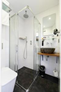 Um banheiro em Quentin Amsterdam Hotel