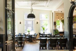 Um restaurante ou outro lugar para comer em Quentin Amsterdam Hotel